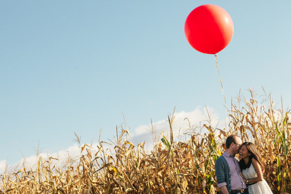 Whimsical balloon in a field for engagement photos. www.rebeccachan.ca